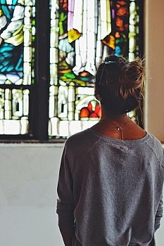 During Doors Open 2014, a visitor admires the (invaluable) stained-glass preserved at the new Saint Antonios Church.